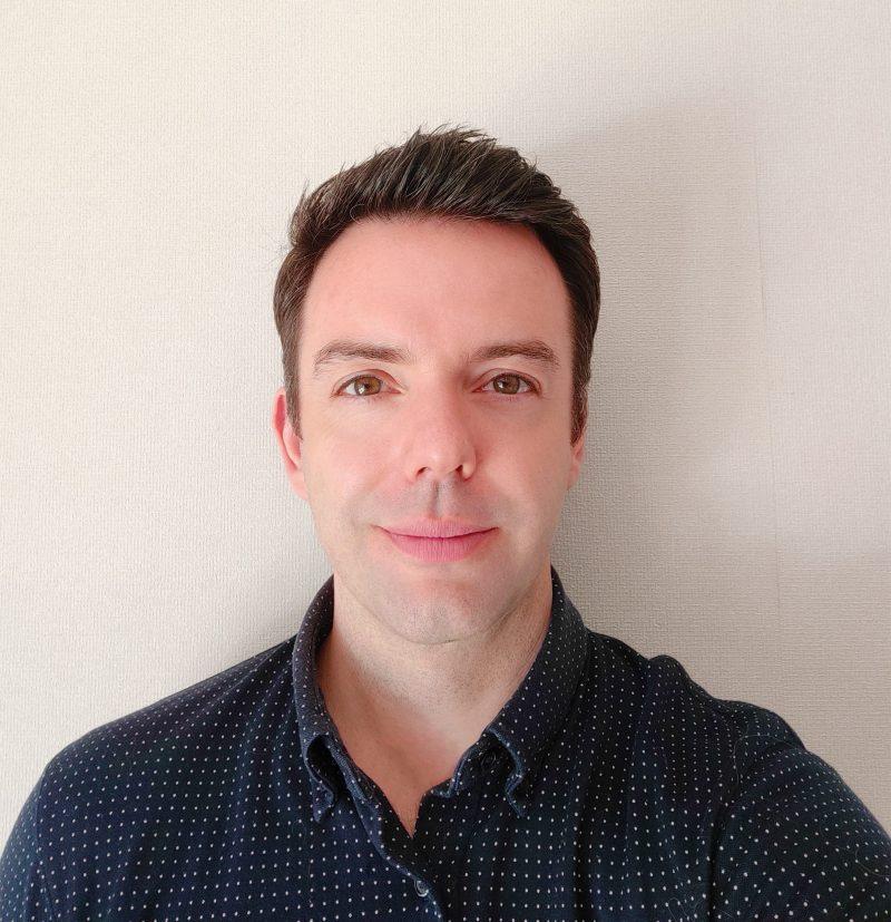 Max Peters Head shot in blue shirt