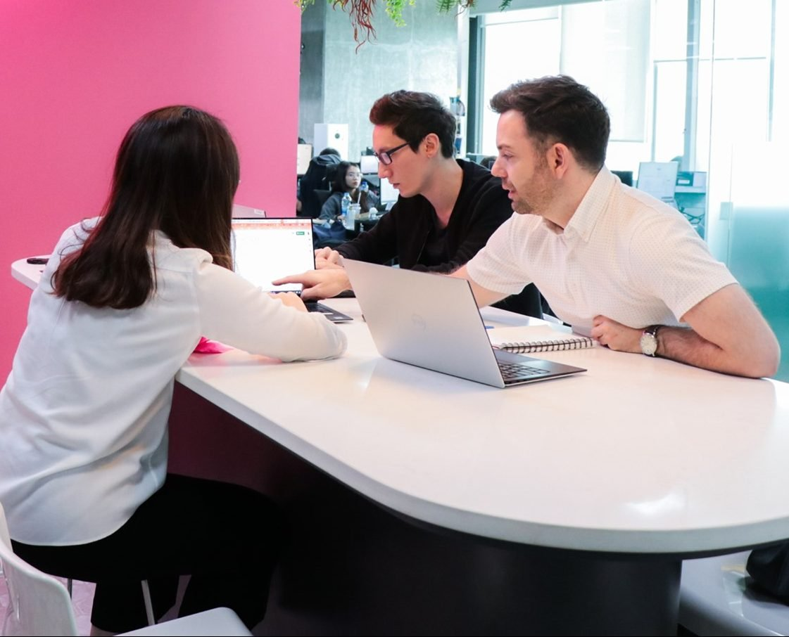 an SEO Consultant works with colleagues